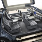 Access to the New Navigator Concept is provided through power gullwing doors and deployable concertina steps.