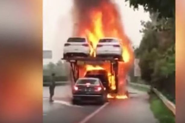 Man-Reverses-Car-Off-Transporter-on-Fire