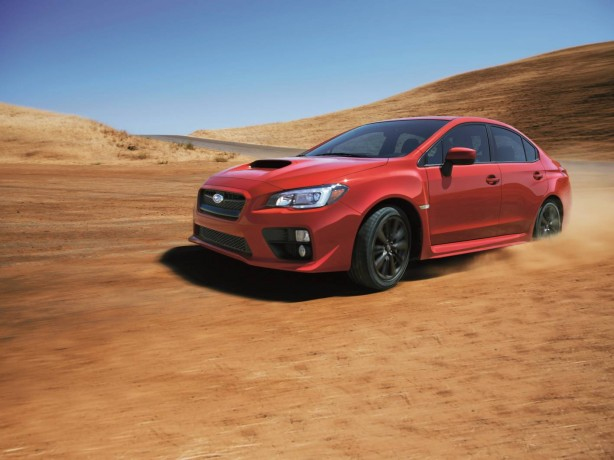 2014 Subaru WRX red front quarter rolling-1