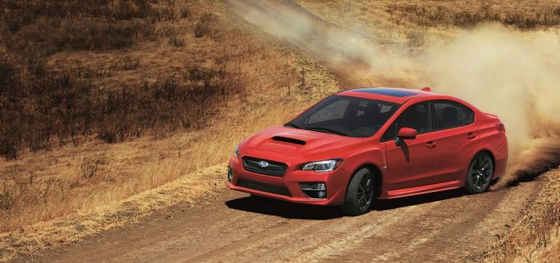 2014 Subaru WRX red front quarter rolling
