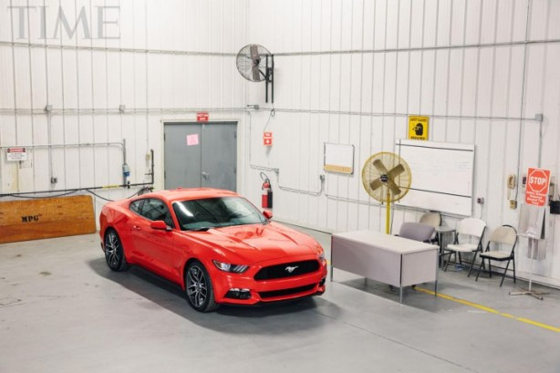 2015 Ford Mustang in work shop front quarter