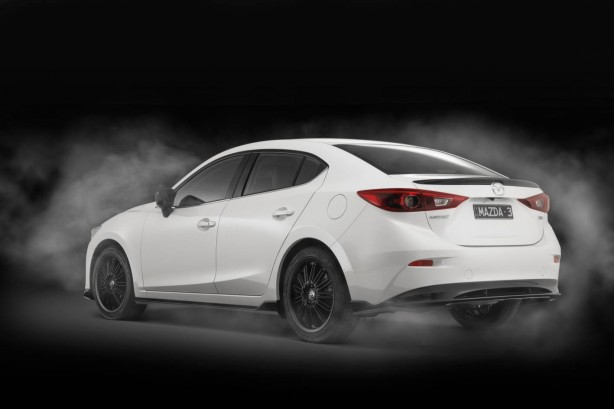 2014 Mazda 3 sedan with Kuroi sports pack rear quarter