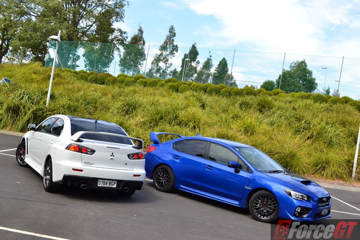 Head to Head: Subaru WRX STI vs Mitsubishi Lancer Evo X ...